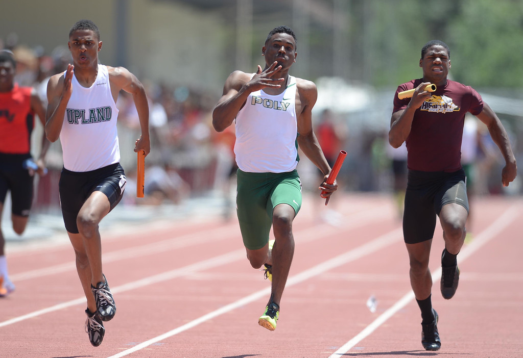 Description of . Upland's DeAngelo Stapleton and Long Beach Poly's Austin Gunter battle for the win in the 4x100  meter Division 1 relay race of the CIF Southern Section Track and Field Championships Saturday at Mt. SAC. 20130518 Photo by Steve McCrank / Staff Photographer