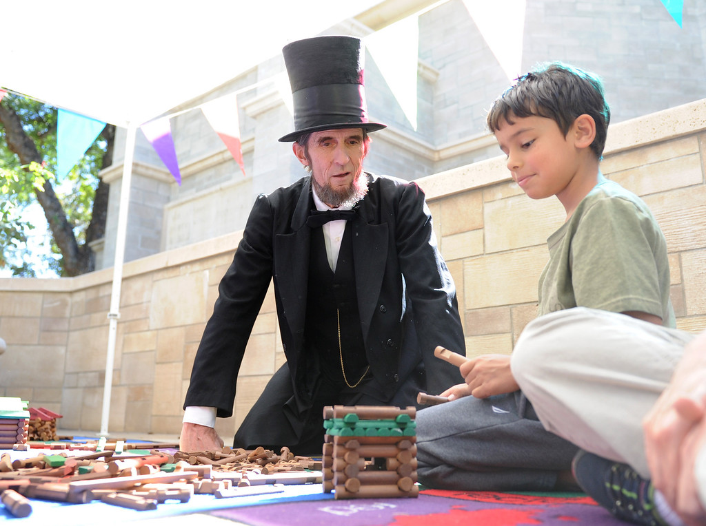 Description of . (John Valenzuela/Staff Photographer)  The A.K Smiley Library in Redlands held their 10th Annual Family Day on Saturday, Oct. 5, 2013. The annual event featured Abraham Lincoln impersonator Robert Broski, author & illustrtor Debra Frasier and a free book for each child in attendance.