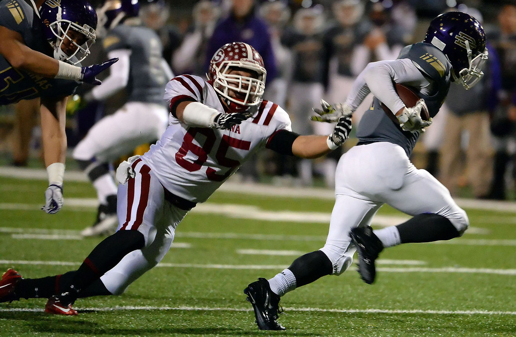 Description of . La Serna's Luis Camacho (85) chases Diamond Bar's Tyler Brown (C) in the first half of a CIF-SS playoff football game at Diamond Bar High School in Diamond Bar, Calif., on Friday, Nov. 22, 2013.   (Keith Birmingham Pasadena Star-News)