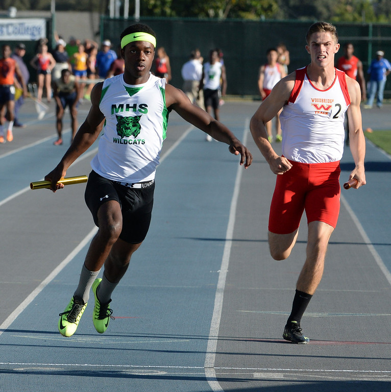 Description of . Monrovia's Cravon Gillespie, left, runs the final leg of the 4x100 race during the CIF-SS Masters Track and Field meet at Falcon Field on the campus of Cerritos College in Norwalk, Calif., on Friday, May 30, 2014.   (Keith Birmingham/Pasadena Star-News)