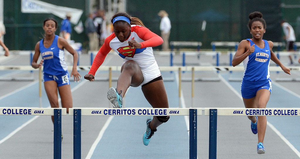 Description of . Serra's Jeanette Paul wins the division 4 300 meter low hurdles during the CIF Southern Section track and final Championships at Cerritos College in Norwalk, Calif., Saturday, May 24, 2014. 
