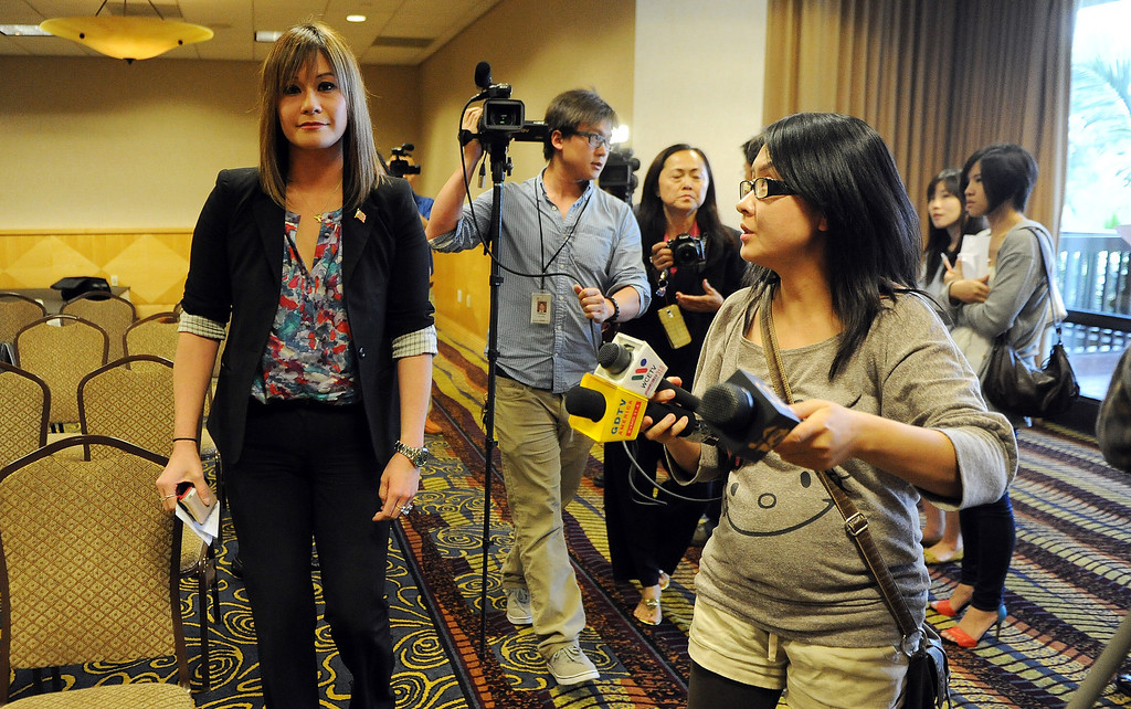 Description of . Media follow Councilwoman Ling Ling Chang R-Diamond Bar as she announces her candidacy for State Assembly, 55th Assembly District during a press conference at Pacific Palms Resort on Friday, May 24, 2013 in Industry, Calif.  (Keith Birmingham Pasadena Star-News)
