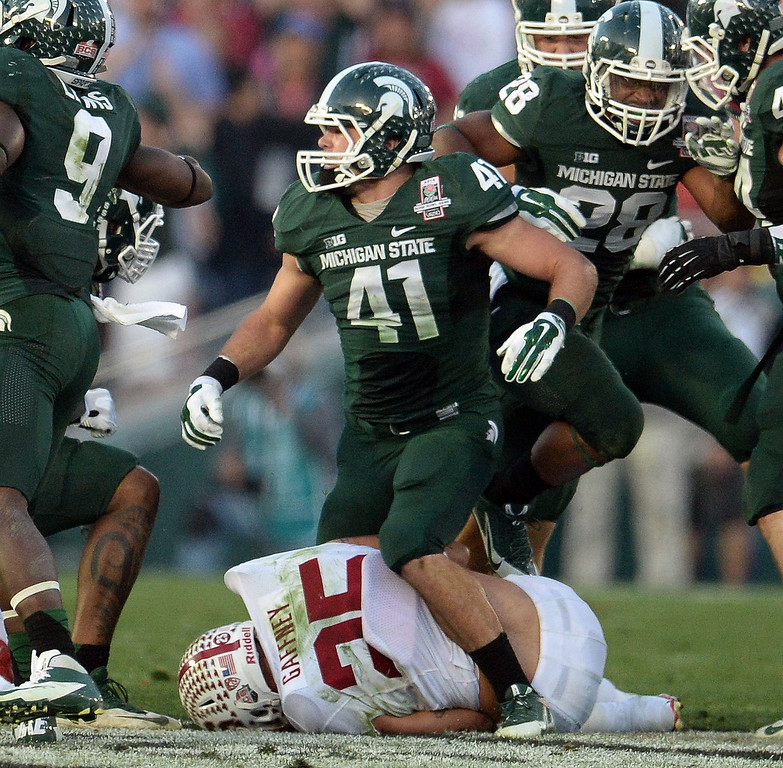 Description of . Michigan State linebacker Kyler Elsworth (41) stands over Stanford running back Tyler Gaffney (25) after a tackle in the second half of the 100th Rose bowl game in Pasadena, Calif., on Wednesday, Jan.1, 2014. Michigan State won 24-20.