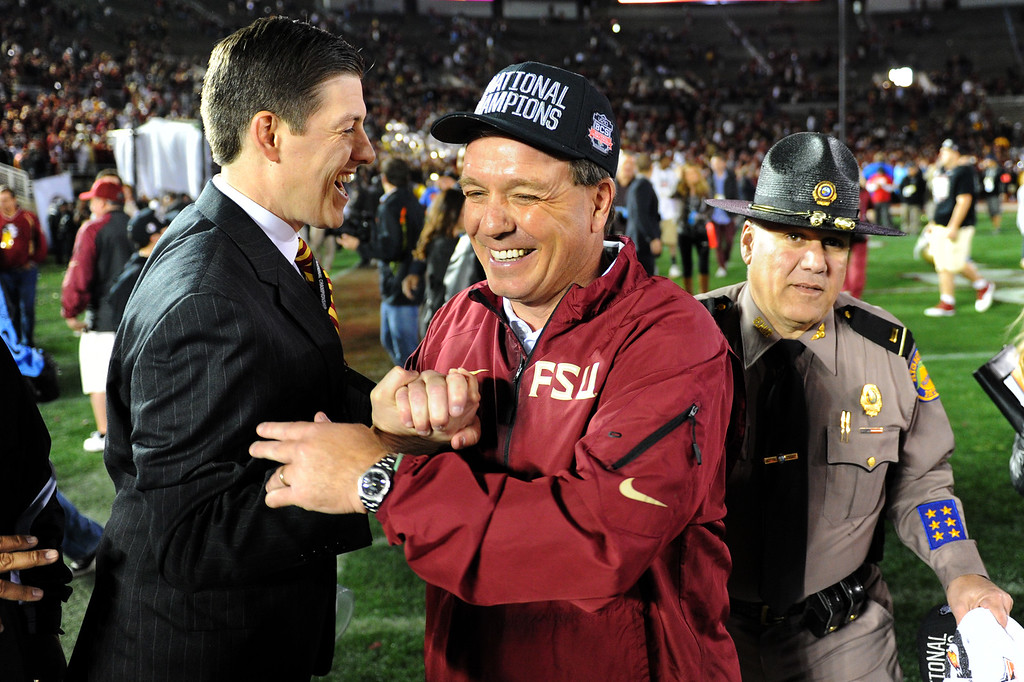 Description of . Florida State head coach Jimbo Fisher is congratulated after beating Auburn 34-31 in the BCS national championship game at the Rose Bowl, Monday, January 6, 2014. (Photo by Michael Owen Baker/L.A. Daily News)