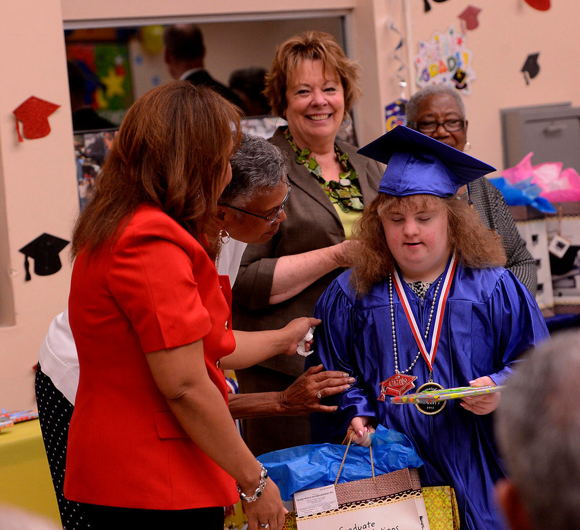 Description of . Graduate Anastasia Shreve receives gifts during Commencement Ceremonies at Carl And Dora Anderson School in San Bernardino May 21, 2013.  GABRIEL LUIS ACOSTA/STAFF PHOTOGRAPHER.