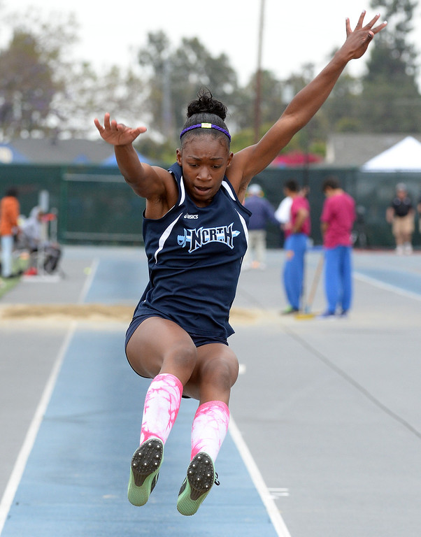 Description of . North's Jasmine Bass competes in the Division 2 long jump during the CIF Southern Section track and final Championships at Cerritos College in Norwalk, Calif., Saturday, May 24, 2014. 