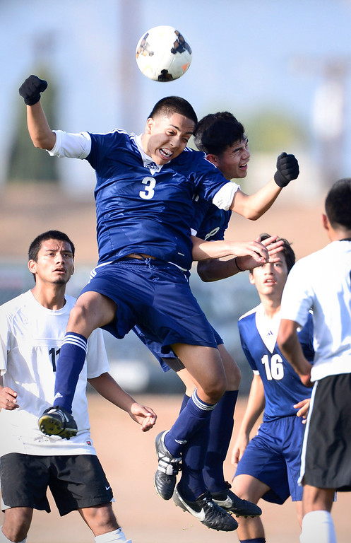Description of . Baldwin Park's Martin Torres (3) and Andy Castillo (8) go for a header as Baldwin Park defeats Northview 2-0 during Tuesday's game at Northview High School, February 11, 2014. (Photo by Sarah Reingewirtz/Pasadena Star-News)