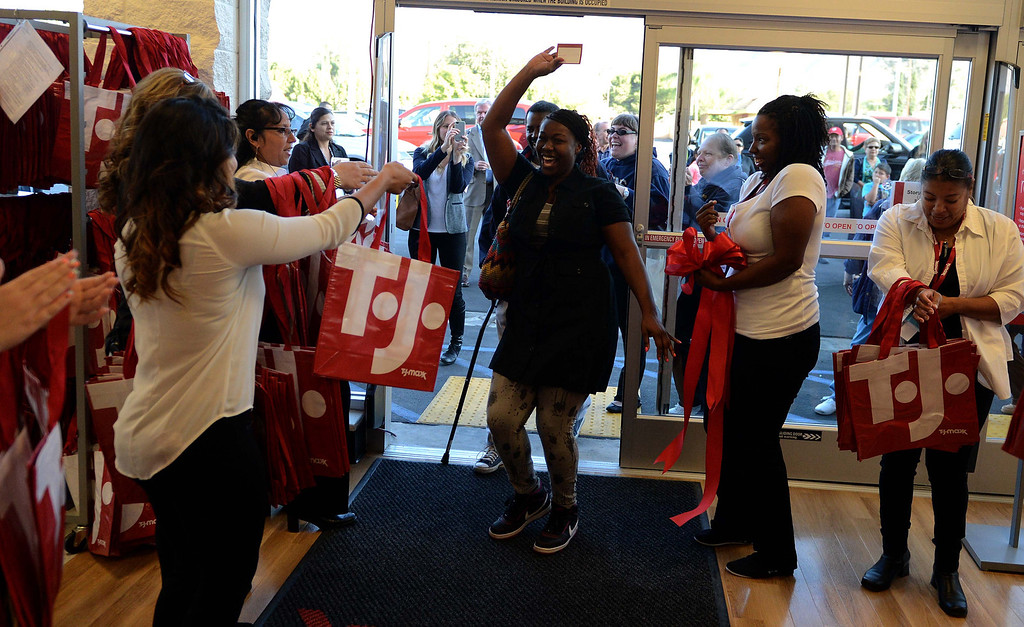 Description of . Hundreds of shoppers came out for the grand opening of the new TJ Maxx store Sunday November 3, 2013 in San Bernardino.LaFonzo Carter