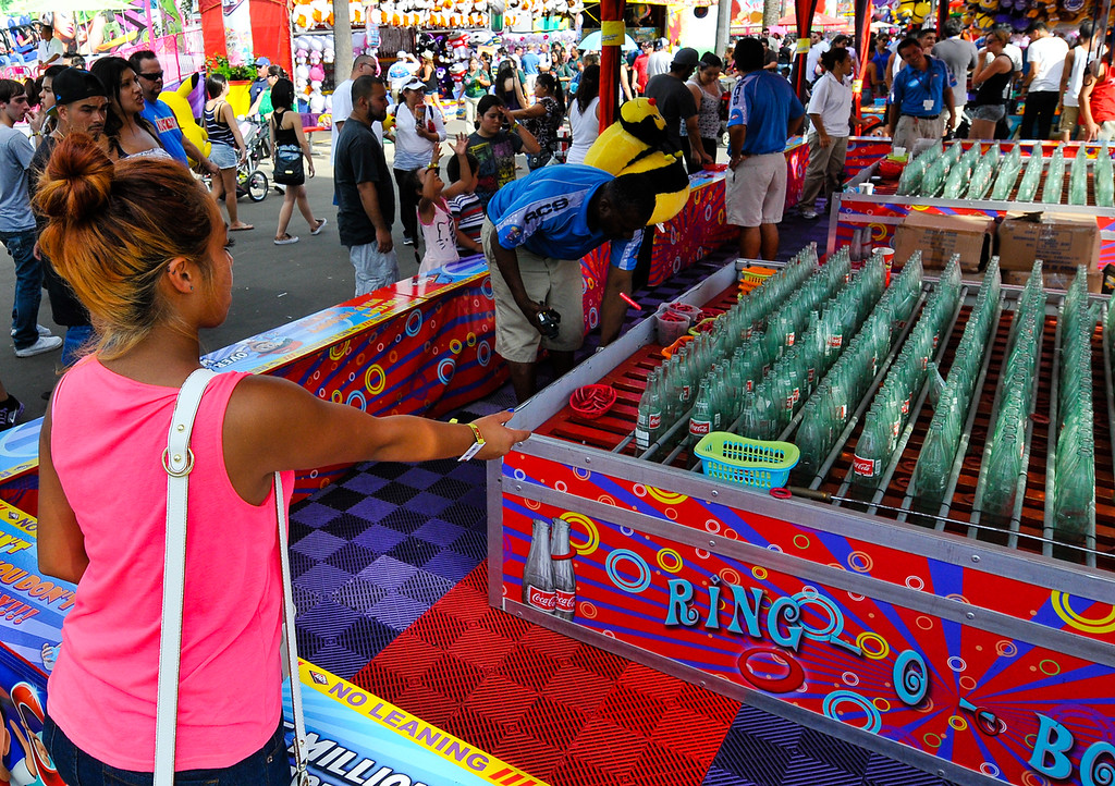 Description of . Fair-goers enjoy Labor Day at the 91st annual Los Angeles County Fair in Pomona on Sept. 2, 2013. The fair will run through September 29. (Rachel Luna / San Bernardino Sun)