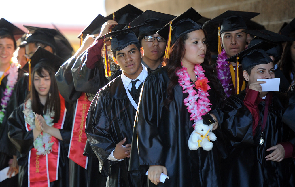 Description of . Students line-up prior to the Vail High School commencement at Vail High School on Tuesday, June 18, 2013 in Montebello, Calif.