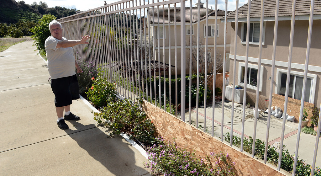 Description of . Ed Heinlein shows barriers he has made behind his home on Ridge View Drive in case the mud from the hills behind their home slides down in Azusa on Thursday February 27, 2014. (Staff Photo by Keith Durflinger/San Gabriel Valley Tribune)