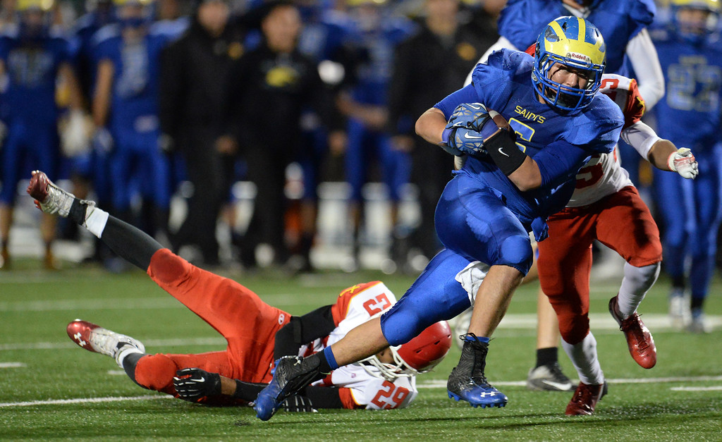 Description of . San Dimas' Fausto Martinez (5) runs past the Paraclete defense in the second half of a CIF-SS Mid-Valley Division championship football game at San Dimas High School in San Dimas, Calif., on Friday, Dec. 6, 2013. San Dimas won 20-14.  (Keith Birmingham Pasadena Star-News)