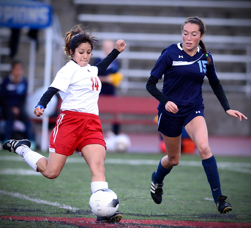 Description of . Camarillo's Angelique Cabral (15) approaches Sierra Vista's Maria Hernandez (14) while she passes as Camarillo defeats Sierra Vista 3-1 in a quarterfinal game at Sierra Vista High School in Baldwin Park, February 28, 2014. (Photo by Sarah Reingewirtz/Pasadena Star-News)