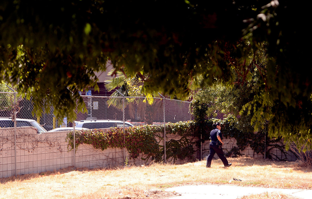 Description of . San Bernardino Police Officer and Homeless Advocate Sochilt Martinez looks for homeless camps in a vacant lot along Ninth Street in San Bernardino August 14, 2013. GABREL LUIS ACOSTA/STAFF PHOTOGRAPHER.