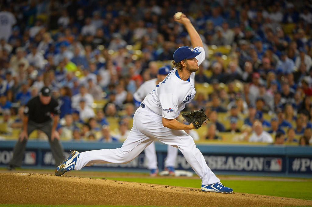 Description of . Dodgers' Clayton Kershaw pitches after a short rest against Atlanta  in game 4 Monday, October 7, 2013 ( Photo by Andy Holzman/Los Angeles Daily News )