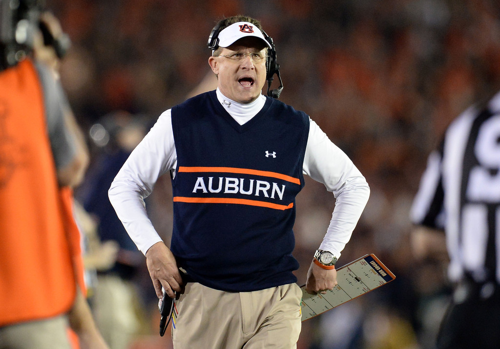 Description of . Auburn head coach Gus Malzahn in the first half of the BCS National Championship game against Florida State at the Rose Bowl in Pasadena, Calif., on Monday, Jan. 6, 2014. 