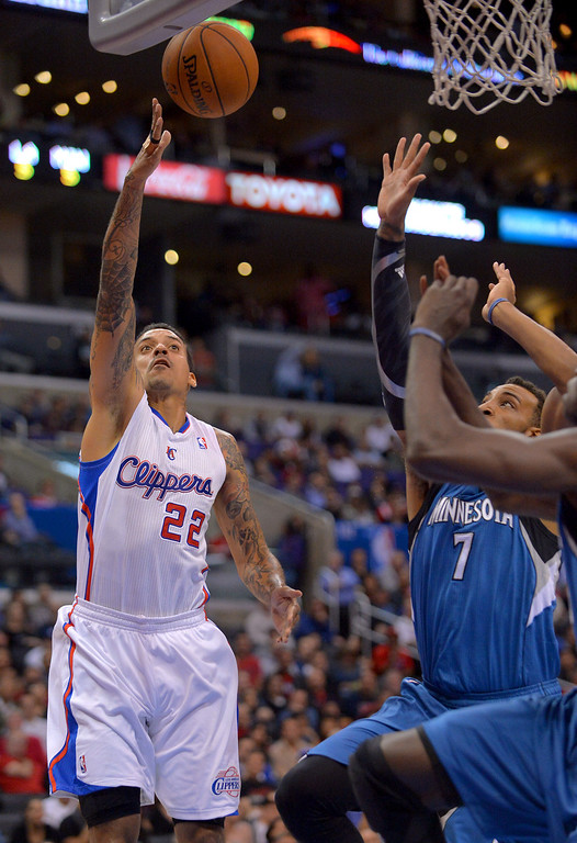 Description of . Los Angeles Clippers' Matt Barnes puts up a shot against the Minnesota Timberwolves during the first half Monday, Nov. 11, 2013, in Los Angeles.(Andy Holzman/Los Angeles Daily News)
