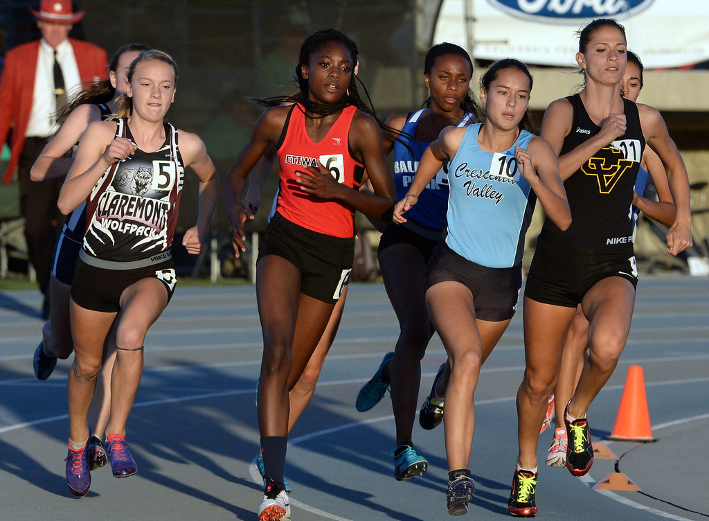 Description of . Claremont's Annie Boos (5) along with Etiwanda's Jacquelyn Hill (6), Crescenta Valley's Megan Melnyk and Baldwin Park's Susie Garza, fourth from right, competes in the 800 meter run during the CIF-SS Masters Track and Field meet at Falcon Field on the campus of Cerritos College in Norwalk, Calif., on Friday, May 30, 2014.   (Keith Birmingham/Pasadena Star-News)