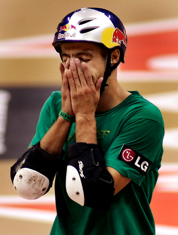 Description of . Sandro Dias of Costa Mesa,Calif., fell on his 3rd try and is shocked, He would finsh 3rd in the Skateboard Vert Men's Final. The Eleventh X Games at the Staple Center in Los Angeles,Calif., August 5. 2005.  (Pasadena Star-News Staff Photo Keith Birmingham/SXSports)