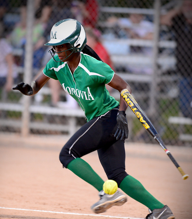 Description of . Monrovia's Elise McCarthy (4) makes a bunt during the West SGV softball all-star game Wednesday night, June 11, 2014 at Live Oak Park in Temple City. (Photo by Sarah Reingewirtz/Pasadena Star-News)