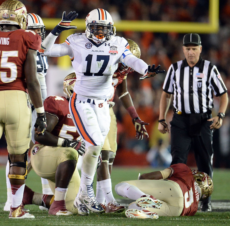 Description of . Auburn linebacker Kris Frost (17) reacts after sacking Florida State quarterback Jameis Winston (5) in the first half of the BCS National Championship game at the Rose Bowl in Pasadena, Calif., on Monday, Jan. 6, 2014.   (Keith Birmingham Pasadena Star-News)