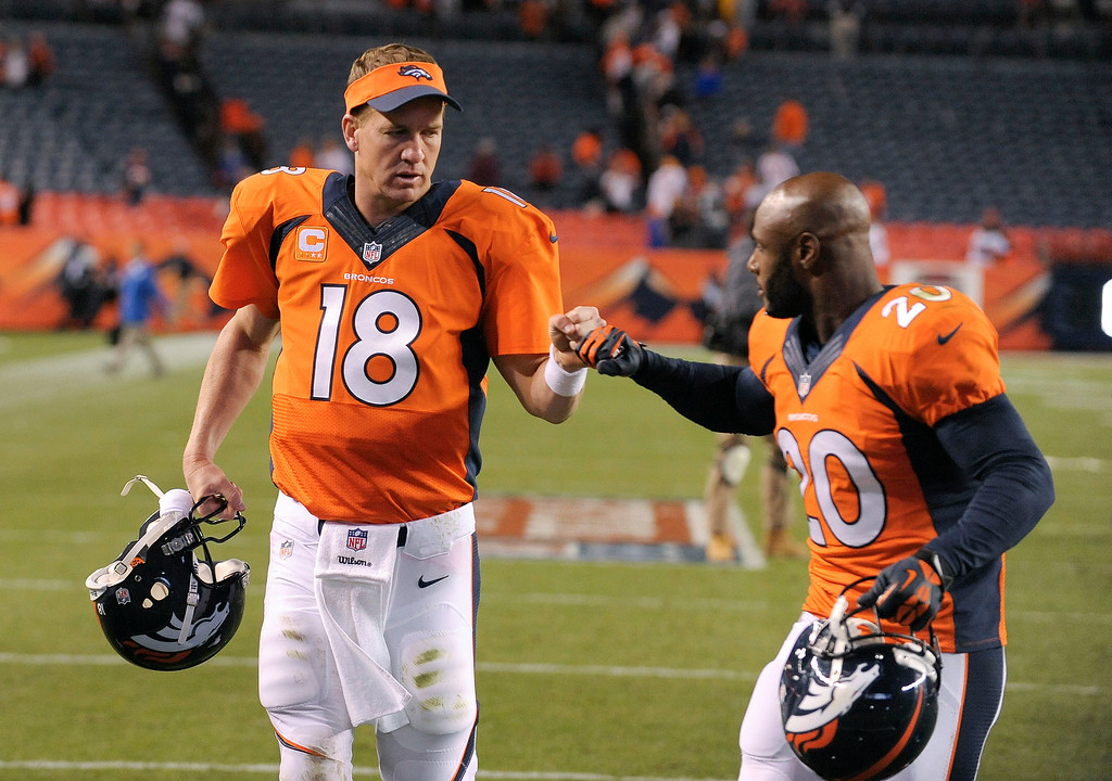 Description of . FILE - In this Sept. 23, 2013, file photo, Denver Broncos quarterback Peyton Manning (18) bumps fists with strong safety Mike Adams (20) after beating the Oakland Raiders 37-21 in an NFL football game in Denver. At 37, with four surgical scars on his neck to match the four MVP awards in his trophy case, Denver\'s quarterback is off to the best start of his storied career.  (AP Photo/Jack Dempsey, File)