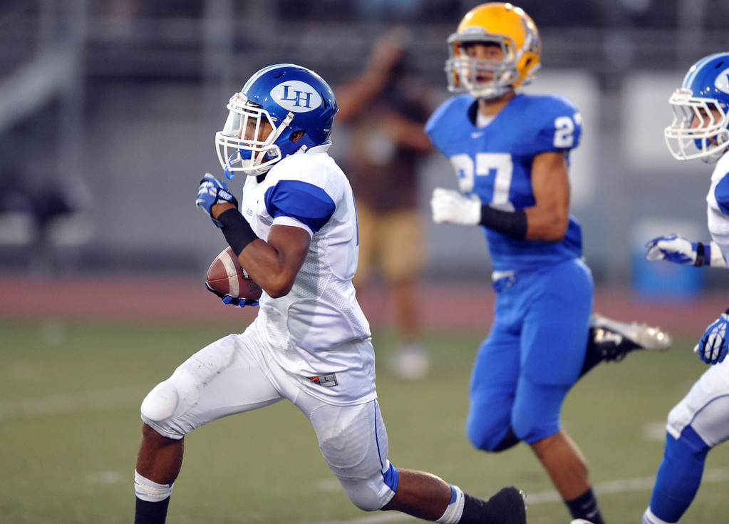 Description of . La Habra wide receiver Elijah Carter (#2) catches the ball and runs for an 80-yard touchdown as they play La Miradain their football game at La Mirada High School on Friday September 6, 2013. (Whittier Daily News/Staff Photo by Keith Durflinger)