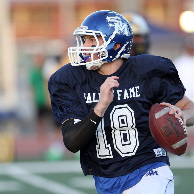 Description of . San Marino's Andrew Ferraco (18) scrambles during the 35th Annual Hall of Fame All-Star Football Game at West Covina High School in West Covina, CA on Friday, May 16, 2014. (Correspondent Photo by David Thomas for the Pasadena Star News)