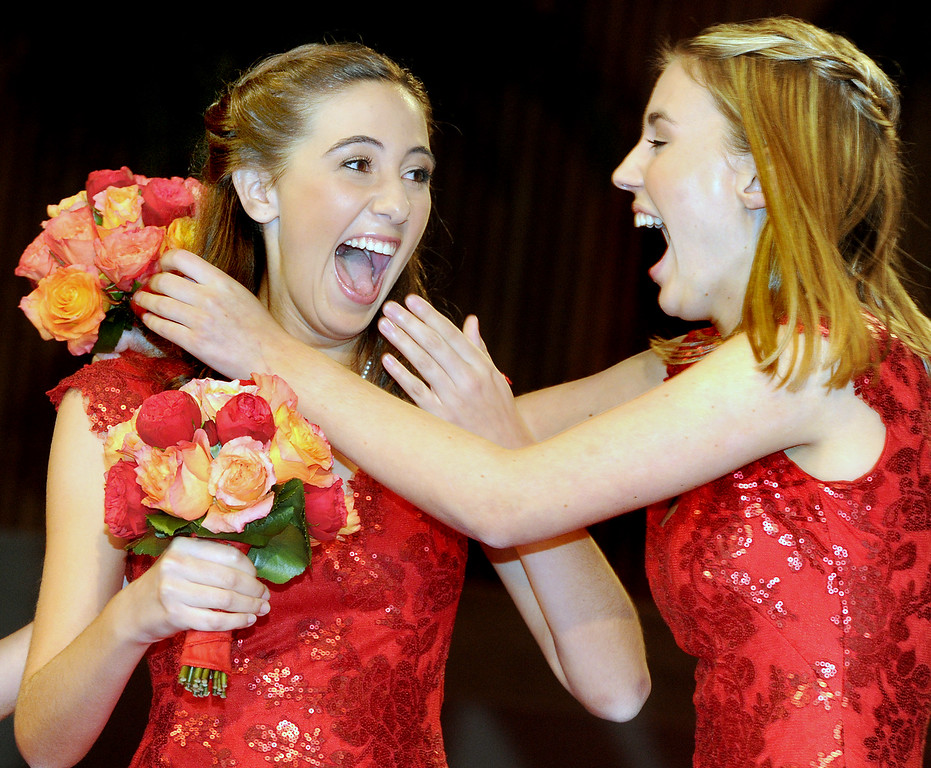 Description of . Ana Marie Acosta, 17, left,  was name Tournament of Roses 96th Rose Queen, being congratulated by Rose Princess Katherine Diane Lipp. Announcement and Coronation of the 96th Rose Queen and Presentation of the 2014 Royal Court  was held at First Church of the Nazarene of PasadenaThursday, October 24, 2013. (Photo by Walt Mancini/Pasadena Star-News)