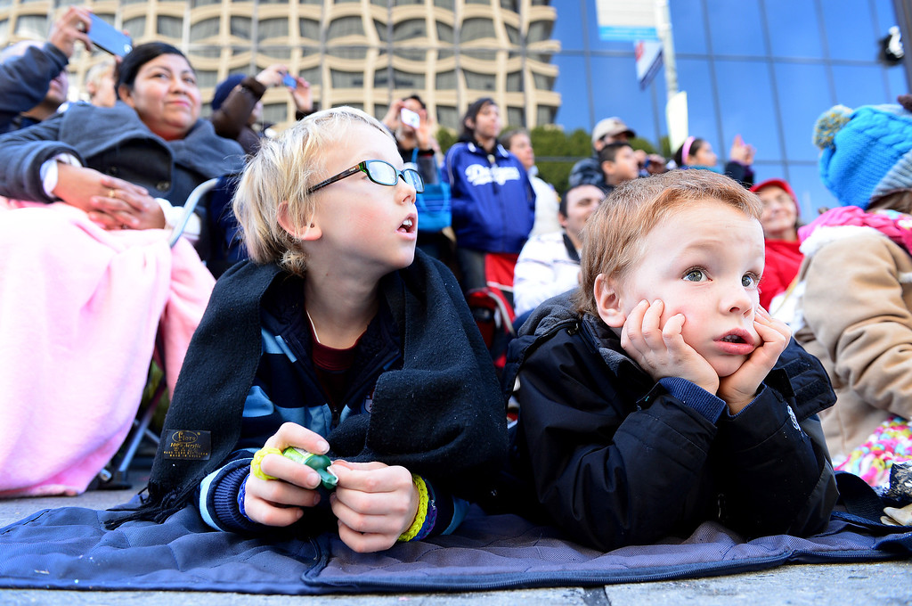 Description of . Luke Danneker, 9, of Northridge, and his brother Cole, 4, watch the 125th Rose Parade as it heads down Colorado Boulevard in Pasadena, CA January 1, 2014. (Photo by Sarah Reingewirtz/Pasadena Star-News)