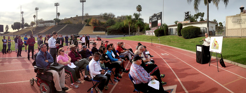 Description of . Panoramic photo of the press conference announcing the renovation of Mt. SAC's Hilmer Lodge Stadium at the Walnut campus Dec. 2, 2013.  The renovation would qualify the stadium to apply for consideration as the track and field venue of the 2020 Olympics.    (Staff photo by Leo Jarzomb/San Gabriel Valley Tribune)