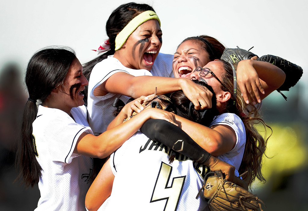 Description of . Northview's Jocelyn Marquez (headband) celebrates with teammates after defeating Barstow 5-4 during a CIF-SS quarterfinal playoff softball game at Northview High School on Thursday, May 23, 2013 in Covina, Calif. Marquez hit a solo home run in the sixth inning to break the tie.  (Keith Birmingham Pasadena Star-News)