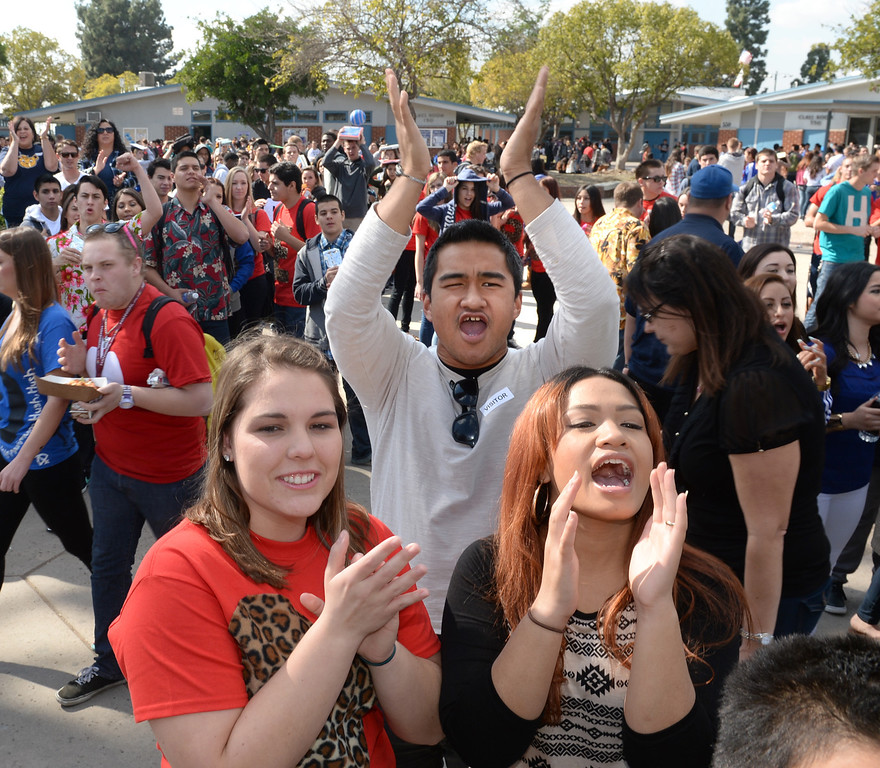 Description of . Students cheer as football and girls soccer players appear during National Signing Day at La Mirada High School on Wednesday February 5, 2014. (Staff Photo by Keith Durflinger/Whittier Daily News)