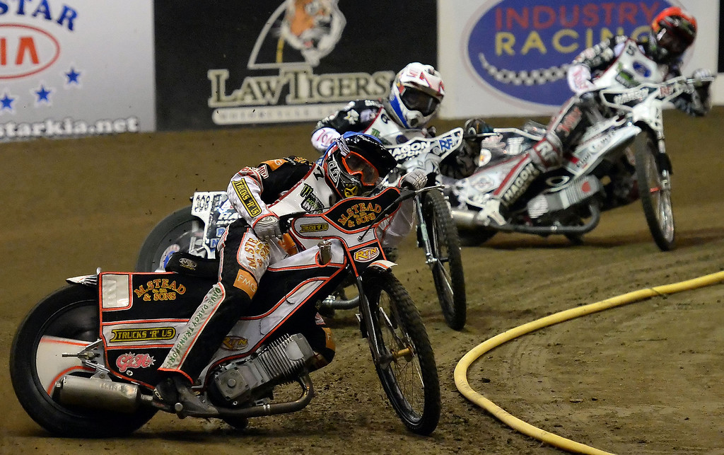 Description of . Scott Nicholls (7) leads in the second race during the Monster Energy Speedway Cycles at the Industry Speedway in the Industry Hills Grand Arena in Industry, Calif., on Saturday, Dec. 28, 2013.     (Keith Birmingham Pasadena Star-News)