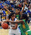 Long Beach Poly defense wraps-up Bishop Amat's Jennifer Vasquez (24) in the first half of a CIF State Southern California Regional semifinal basketball game at Bishop Amat High School on Tuesday, March 12, 2013 in La Puente, Calif. Long Beach Poly won 52-34. 