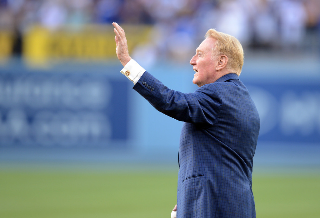 Description of . Vin Scully waves to fans during Vin Scully Bobblehead Night at Dodger Stadium in Los Angeles Thursday, August 30, 2012. (Hans Gutknecht/L.A. Daily News)