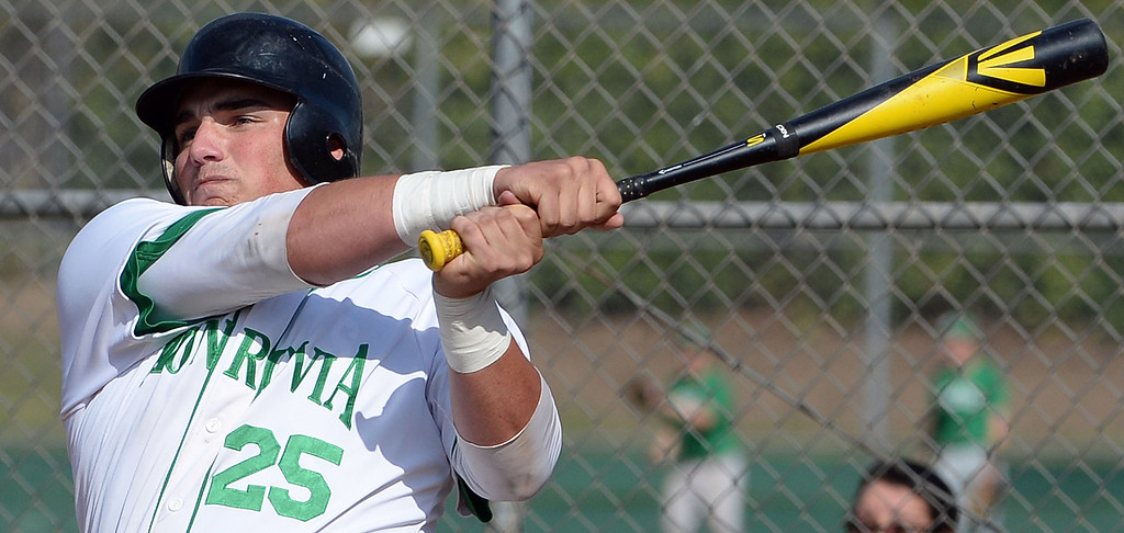 Description of . Monrovia's Jason Daly watches his RBI single as Nick Carino (not pictured) scores against Alhambra in the first inning of the Arcadia Elk Baseball Tournament at Monrovia High School in Monrovia, Calif., on Thursday, March 13, 2014. Monrovia won 2-0.  (Keith Birmingham Pasadena Star-News)
