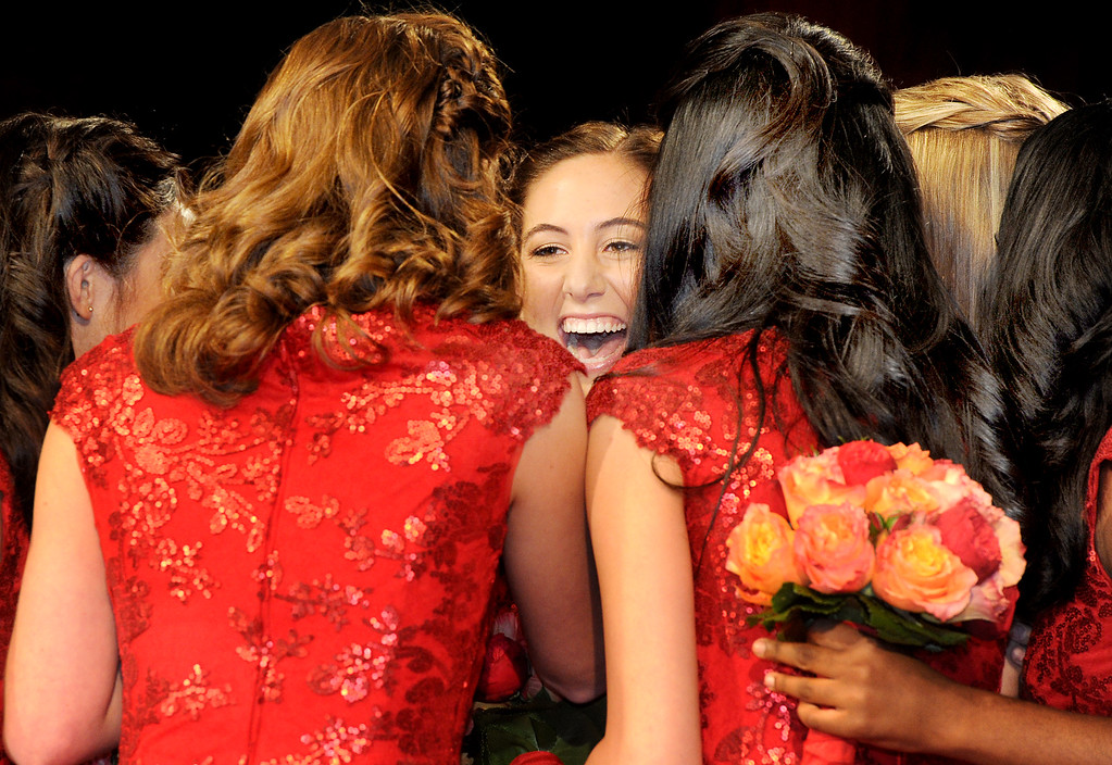 Description of . Ana Marie Acosta, center,17, being congratulated by Royal Court after announcement of that she will become the 96th Rose Queen. Tournament of Roses Announcement and Coronation of the 96th Rose Queen and Presentation of the 2014 Royal Court held at First Church of the Nazarene of PasadenaThursday, October 24, 2013. (Photo by Walt Mancini/Pasadena Star-News)