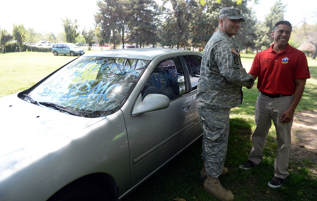 "Description of . Jose Gonzalez, right, shakes hands with U.S. Army Sgt. Diego Rodriguez of West Covina after donating the car to Rodriguez during ""Heroes in the Shadows"" San Gabriel Valley Homeless Stand Down, A three day event presented by The Vet Hunters Project and The SGV Veterans Employment Committee aims to combat Homelessness by providing on site assistance, services and resources to those in need at Whittier Narrows Recreation Park in South El Monte, Calif., on Saturday, April 5, 2014.  (Keith Birmingham Pasadena Star-News)"