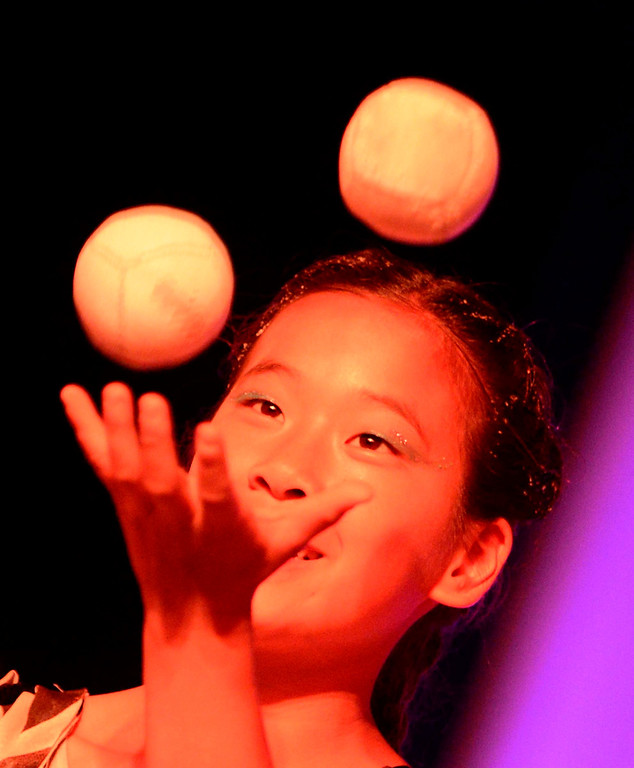 Description of . A young girl juggles during the Great Y Circus in Redlands May 3, 2013.  GABRIEL LUIS ACOSTA/STAFF PHOTOGRAPHER.
