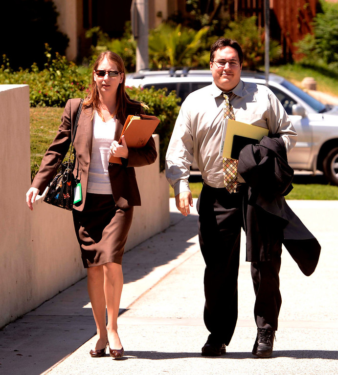 Description of . Staff of City Attorney James Penman arrive to the United States Bankruptcy court in Riverside August 28,2013.  A tentative ruling by a Federal judge grants San Bernardino bankrupty protection.  GABRIEL LUIS ACOSTA/STAFF PHOTOGRAPHER.