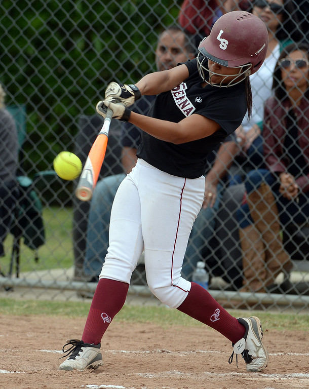 Description of . La Serna's Raeanne Martinez RBI double in the second inning of a prep playoff softball game against Bishop Amat at Bishop Amat High School in La Puente, Calif., on Thursday, May 22, 2014. La Serna won 6-0.   (Keith Birmingham/Pasadena Star-News)