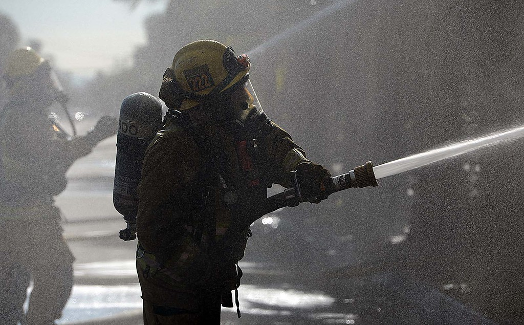 Description of . More than 20 fire units, from at least five agencies, fight a third-alarm fire Tuesday December 31, 2013 at an abandoned bowling alley, once known as the San-Hi Lanes, in San Bernardino on the corner of Western Avenue and Highland Avenue. (Staff photo by Rick Sforza/The Sun)