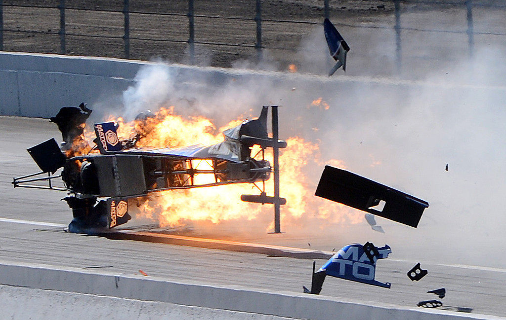 Description of . Top Fuel driver Antron Brown's dragster suffers a major engine explosion blowing out both his rear tires while racing at over 300mph and crashing violently Sunday in Pomona. Brown was uninjured in the fiery crash February 17, 2013 at the 53rd annual NHRA Winternationals in Pomona. (Staff photo by Will Lester)