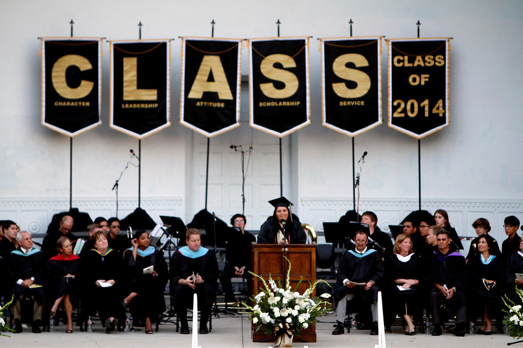 Description of . Citrus Valley High School graduate Laura Flores, center, speaks during commencement on Wednesday, June 11, 2014 at the Redlands Bowl in Redlands, Ca.  (Photo by Micah Escamilla/Redlands Daily Facts)