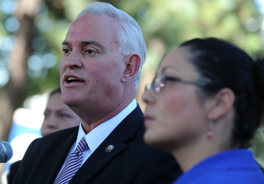 Description of . City of Downey mayor , DN. Mario A. Guerra, left, with assembly member Cristina Garcia (D-Bell Gardens) speaks during a press conference calling for Senator Ron Calderon to resign his position in the California State Senate in front of the Bell Gardens City Hall in Bell Gardens , Calif., on Wednesday, Nov. 13, 2013.   (Keith Birmingham Pasadena Star-News)