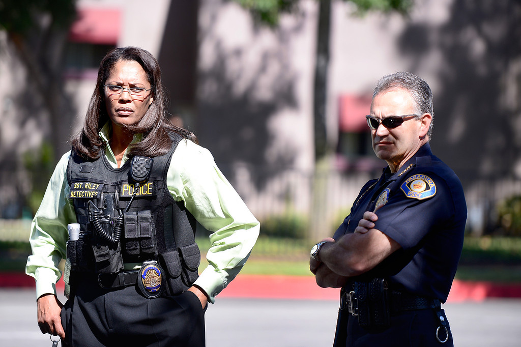Description of . Pasadena Police Chief Phillip Sanchez, right, and Detective Sgt. Tory Riley standby as Pasadena Police investigate an officer involved shooting at Kings Village in Pasadena Friday, October 11, 2013. (Photo by Sarah Reingewirtz/Pasadena-Star News)