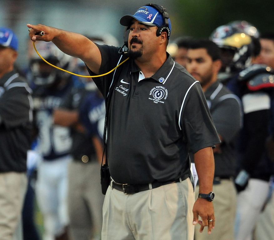 Description of . West head coach Joel Sanchez in the first half of the annual East vs. West San Gabriel Valley Hall of Fame all-star football game at West Covina High School on Friday, May 17, 2013 in West Covina, Calif. 