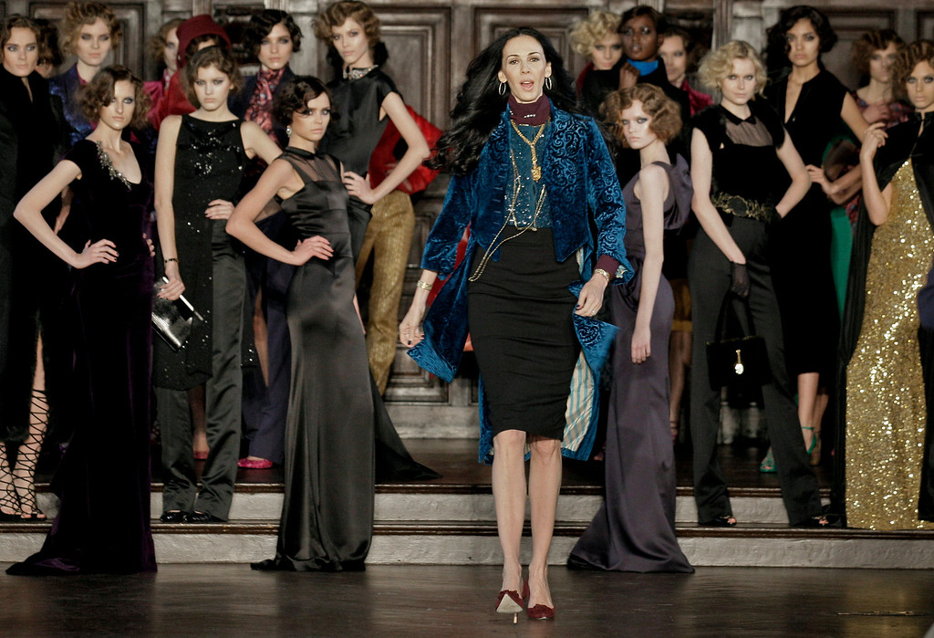 Description of . FILE - This Feb. 16, 2012 file photo shows designer L'Wren Scott, center, after her Fall 2012 collection was modeled during Fashion Week, in New York. Scott was found dead Monday, March 17, 2014, in Manhattan of a possible suicide. (AP Photo/Richard Drew, File)