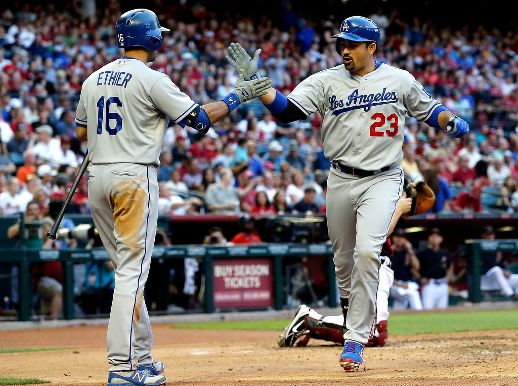 Description of . Los Angeles Dodgers' Adrian Gonzalez (23) celebrates his solo home run with teammate Andre Ethier (16) against the Arizona Diamondbacks during the fourth inning of a baseball game on Saturday, April 13, 2013, in Phoenix. Dodgers won 7-5  (AP Photo/Matt York)